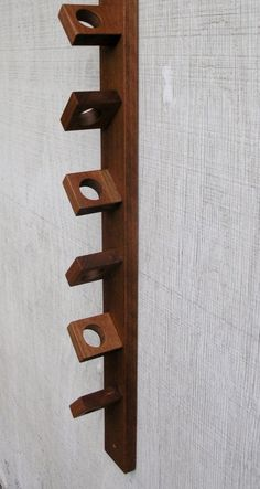 Modern Rustic Hanging Wood Wine Rack Exotic by ReclaimedTrends…could be made from bits of hardwood scraps or for a more rustic look, the construction scrap heap Wine Rack Wall, Wood Wine Racks, Wine Rack Design, Deco Cool, Pallet Wine, Wine Bottle Holders, Wine Storage, Wood Design, Wood Furniture
