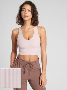 FOR: Yoga or studio practiceFEEL: Chafe-free seamless fabric stretches with every moveFAVE: Rib texturePairs back to high-rise bottomsFitted close to the skinDeep plunging necklineBody length in size medium: 16''