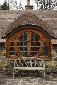 'Hobbit' House In Pennsylvania-eyebrow roof line, circle window