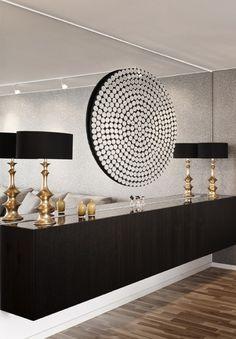 Mirrorwall....circular mirror on mirror behind wall hung credenza