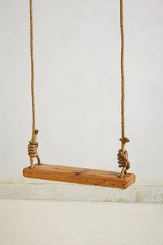 make an old fashioned tree swing out of rope and a sanded 2 x 4
