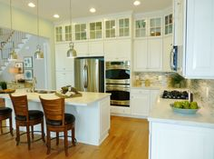 LOVE the Glass Transom Cabinets & Counter Space (Not Granite ~ Corian)  the Ryan Homes POTOMAC SHORES Model Home