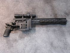 300 Blackout AR suppressor   The optic is sport is very nifty. It has a custom Leupold scope that ...