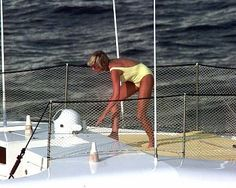 1997: Princess Diana in a yellow one piece swimsuit, on board the Jonikal, St Tropez.