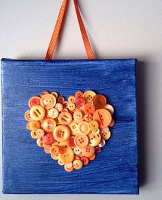 Handmade button mosaic heart mounted on 8x8 canvas.  Only at MosaicTreasureBox, $22.00