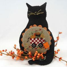 Pinner said: A cute Halloween decoration ready to hang in your haunted home. This Halloween decoration started at the center with a cross stitched design Cute Halloween Decorations, Halloween Trees, Halloween Cat, Fall Cross Stitch, Cross Stitch Finishing, Cross Stitch Designs, Cross Stitch Patterns, Cat Work, Halloween Cross Stitches