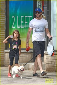 Hugh Jackman and his daughter Ava take their dog for a walk on June 23, 2013