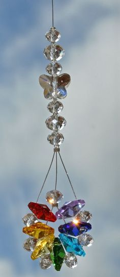 Feng Shui Chakra Wheel Sparkling Crystal by CrystalsAndRainbows Mobiles, Chakra Crystals, Stones And Crystals, Swarovski Crystals, Feng Shui, Diy Wind Chimes, Beaded Ornaments, Snowman Ornaments, Beads And Wire