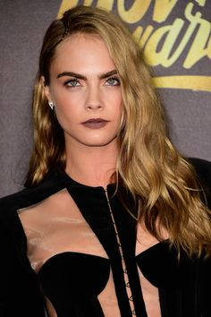 Cara Delevingne Photos Photos - Actress/model Cara Delevingne attends the 2016 MTV Movie Awards at Warner Bros. Studios on April 9, 2016 in Burbank, California.  MTV Movie Awards airs April 10, 2016 at 8pm ET/PT. - 2016 MTV Movie Awards - Arrivals