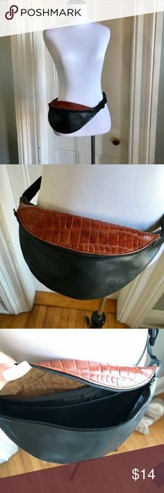 """FESTIVAL black & brown leather fanny pack belt bag EUC! Genuine leather black with brown faux croc.  Perfect for Festival season! Front large zippered compartment fits iPhone Plus.  Top zippered compartment is behind the other compartment perfect for storing your money/credit cards/ID safely.  Adjustable waist strap. Smoke Free/Pet Free. 11"""" length. 5"""" height.  Offers Are Welcomed. All Sales Are Final. Unknown Bags Clutches & Wristlets"""
