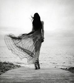 woman, taken by the wind...something like this by the cliffs that's long and has movement. feels powerful