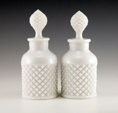 English Hobnail Vanity Bottles in Milk Glass Thick white diamond patterned milk glass widely attributed to Westmoreland Glass, but may be by Duncan Glass circa 1920s.
