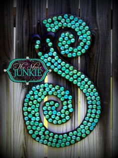 Cute outdoor decoration. Wooden letter from crafts store, flat marbles from dollar store.