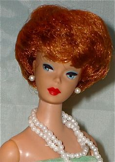 I hated when I got stuck with this Barbie.  You could just spin your hand around her head to fix her hair.