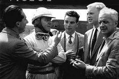 Silverstone, July 1953: At the British Grand Prix the four Ferrari drivers discuss tactics, along with French journalist/photographer Bernard Cahier. From left to right: Alberto Ascari, Giuseppe Farina, Bernard Cahier, Mike Hawthorn and Luiggi Villoresi.