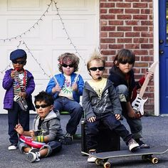 Get the neighborhood boys (and girls!) together and let them rock out! Dress them in comfortable concert performance outfits like graphic tees, striped shirts, hoodies, dark jeans, and sneakers. Then add some instruments (a toy guitar, a set of drum sticks), plus some hats and hip shades. And make sure to gel some hair!