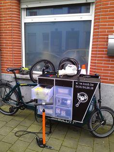 Mobile bike repair shop.
