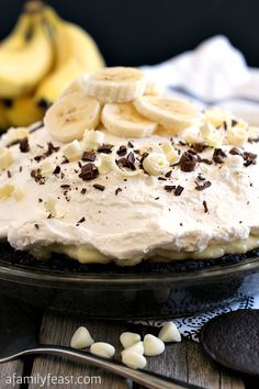 This amazing White Chocolate Banana Cream Pie is one of the best pies I've ever had! Layer upon layer of dark chocolate crumbs, banana slices, white chocolate custard and whipped cream make this one AMAZING pie recipe! The #SweetestSecret to making this pie so delicious? Ghirardelli Chocolate