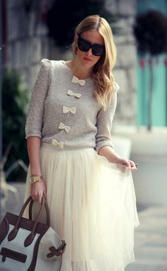 White tulle midi skirt, grey button up sweater with white bows