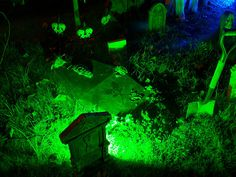 Glow sticks behind gravestones.