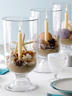 Candle Seashell Centerpiece - Easy candle hurricanes complete with beach sand, simple tapers, caramel and white shells.   Elegance at the beach!