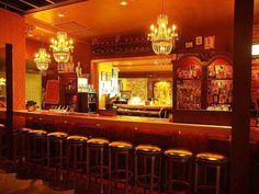 Hines wanted this room, the bar of an Atlanta tapas restaurant, to transport patrons back in time to a speakeasy bar. Ornate chandeliers, shades of burnt sienna and retro bar stools complete the space.
