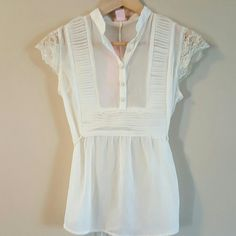 Sheer babydoll top Sheer off white babydoll top with button down front and lace sleeves. nolita Tops Button Down Shirts