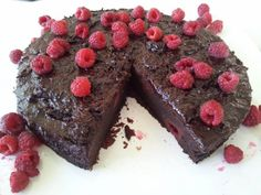 "Chocolate Cake with Raspberries - lovely soft sponge cake with raspberries woven into the texture - moist topping.  This is not too rich.  Cooked using the Gooey Chocolate Cake Recipe from Bill Granger's, ""Feed Me Now Cookbook"":  http://www.harpercollins.com.au/books/Feed-Me-Now-Bill-Granger/?isbn=9780732289744"