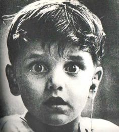 Harold Whittles hears for the first time ever after a doctor places an earpiece in his left ear.  40 Of The Most Powerful Photographs Ever Taken