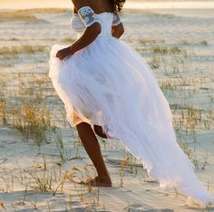 Dreamy wedding dress featuring lace arm bands and soft tulle skirt