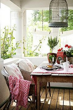 Wicker and an old farm table...throw in some gingham...ahhhh...