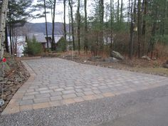 Driveway aprons are a great location to use permeable paver systems to prevent storm water runoff from coming down a driveway. Water is filtered through the voi… Permeable Driveway, Driveways, Driveway Apron, Mailbox Makeover, Kerb Appeal, Driveway Design, Cool Photos, Sidewalk, Backyard