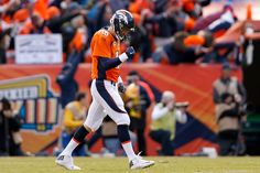 Peyton Manning #18 of the Denver Broncos celebrates after passing for a 12-yard touchdown in the second quarter against the New England Patriots in the AFC Championship game at Sports Authority Field at Mile High on January 24, 2016 in Denver, Colorado. (Jan. 23, 2016 - Source: Christian Petersen/Getty Images North America)