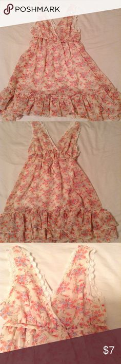 """Baby Doll Floral  Chiffon Dress Baby Doll Floral  Chiffon Dress. """"V"""" shapped top with flower detail. Ties in the back. Flowy and short. Worn once! Runway Paris Dresses Mini"""