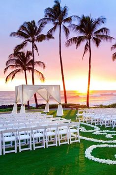 wedding on the beach with our beautiful white resin chairs!