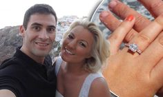 Salman Rushdie's son Zafar popped the question to classical singing sensation Natalie Coyle on a surprise trip to Greece, giving her a stunning three-carat engagement ring featuring an Asscher cut diamond http://dailym.ai/1rkjVcx