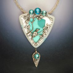 Vicki Hallmark - Metal Clay, Sterling, Faux Bone, Resin and Rainbow Topaz