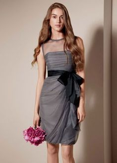 Bobbin net dress with illusion neckline.  Bobbin net dress with illusion neckline, ruched bodice, and asymmetrically draped bubble skirt. Dress comes with black taffeta sash.   Personalize with sashes and accessories.  Fully lined. Side zip. Imported. Dry clean only.