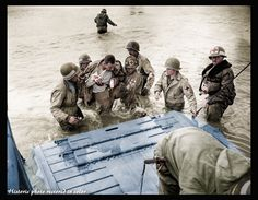 D-Day 6:30 AM,landing is in progress on the Utah and Omaha beach.  Nursing the 2nd NBB help a wounded paratrooper to get into a health LCVP on Utah beach. The trademarks of their kegs are of great variety: red cross on a white square, and arc blue circle for the fire of the 1st Engineer Special Brigade