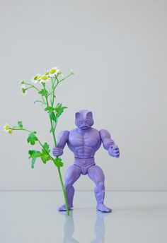 spray paint an action figure and place a petite flower in his hand