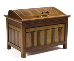 SECESSIONIST / AUSTRIAN SCHOOL  COFFER, CIRCA 1900,  mahogany, birch and stained wood, the domed hinged lid inlaid with rectangular panels above panelled sides, similarly decorated, block feet  73cm wide, 56cm high, 47cm deep
