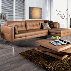 A gorgeous corner sofa in soft leather with a hand stitched detail on the seat, cushions and outer surround helping to create a real statement piece for any living room. Sitting on stainless steel legs this sofa range offers contemporary styling at a great price.