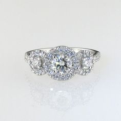 Trilogy and halo diamond Ring Three Stone Rings, Halo Diamond, Engagement Rings, Jewellery, Enagement Rings, Wedding Rings, Jewels, Jewelry Shop, Schmuck