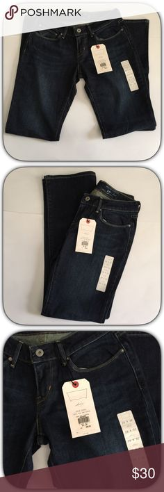 NWT Dark Blue Curvy Slim Boot Cut  Levi's Jeans These are brand new! All tags still attached! I just never returned after gaining some weight! ! ! Nice shade of dark blue! Size 28 Inseam 32 Levi's Jeans Boot Cut