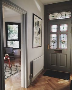 This Worsted front door looks wonderful against the complementary Pavilion Gray and Railings woodwork in Michelle's hallway.