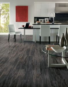 Armstrong Chelsea Park Mineral Forest  8 mm Laminate Wood Look. mix of blacks, greys, and beige that it actually makes the room brighter and the pattern makes it so great to hide any dirt or dust. It sweeps up so clean and you can use the floor cleaner to shine it right up.