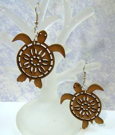 Very unique wooden Turtle earrings-lacey carved design- Hypoallergenic steel fish hook ear wires-see photos. Very lightweight-delicate Measurements: Lovely earrings!