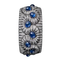 High Jewelry bracelet High Jewelry <br />Cartier Royal <br />bracelet, platinum, twelve cabochon-cut sapphires totaling 35.44 carats from Burma, brilliant-cut diamonds.