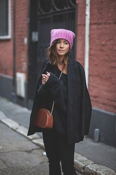 All black outfit + brown leather purse and pink toque