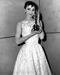 Audrey Hepburn 1950s Actress wearing full skirted dress and cute pixie cut. Vintage Fashion & Style Hollywood's Golden Age Photos Hollywood